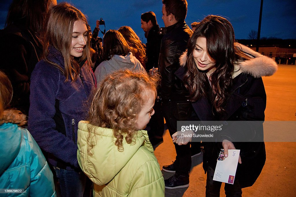 Actress Miranda Cosgrove meets children of military personnel at Naval Submarine Base New London on January 11, 2012 in Groton, Connecticut. Cosgrove and the cast of iCarly were presenting a special military family screening of iMeet The First Lady, an episode of their show featuring Michelle Obama.