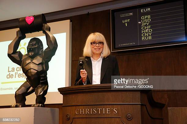 Actress Mireille Darc at an auction.