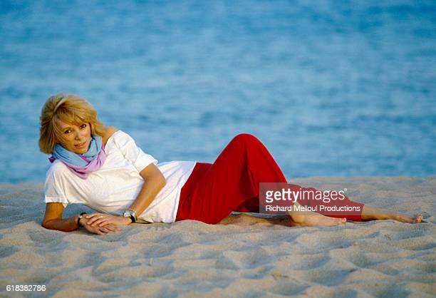 Actress Mireille Darc Lying on Beach