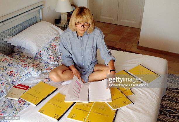 Actress Mireille Darc reviews her scripts while in the French Riviera filming her television series Les Coeurs Brules