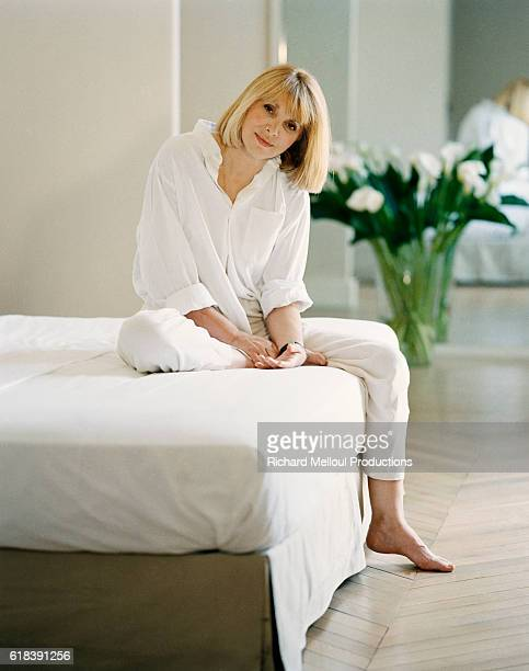Actress Mireille Darc Sitting on Bed