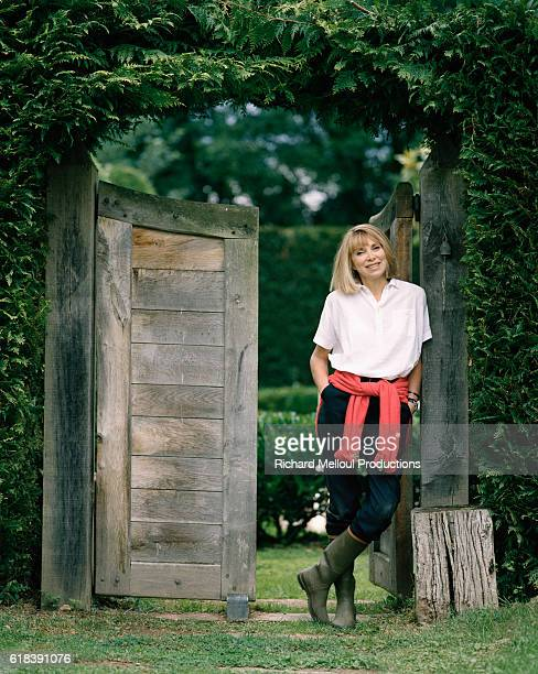 Actress Mireille Darc Standing by Gate