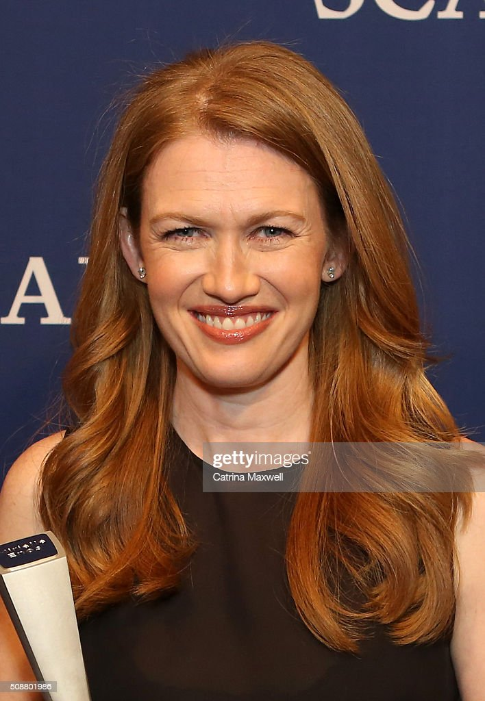 Actress Mireille Enos poses with her SCAD Spotlight Award during aTVfest 2016 on February 6 2016 in Atlanta Georgia