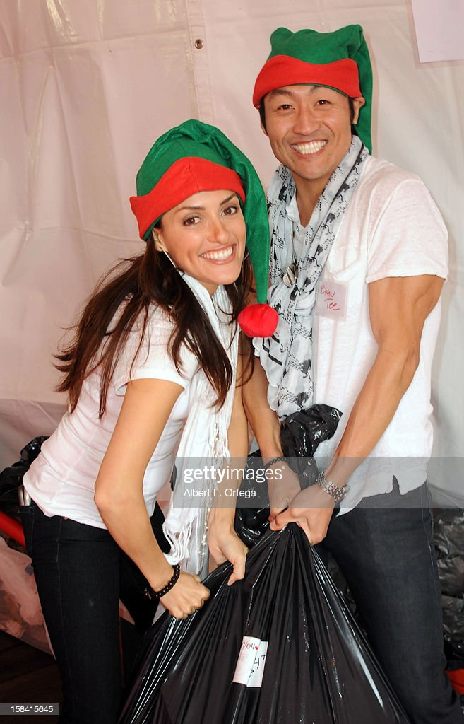 Actress Mirelly Taylor and actor Brian Tee participate in The Heartfelt Foundation's 33rd Annual Christmas/Holiday Party For Children In Need held at The Santa Monica Pier on December 15, 2012 in Santa Monica, California.