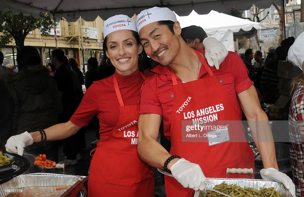 Actress Mirelly Taylor and actor Brian Tee participate in the Los Angeles Mission Christmas Eve lunch For The Homeless held at the Los Angeles Mission on December 24, 2012 in Los Angeles, California.
