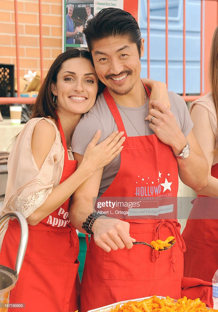 Actress Mirelly Taylor and actor Brian Tee participate in the Hollywood Chamber of Commerce's annual police and firefighters appreciation day at the Hollywood LAPD station on November 28, 2012 in Hollywood, California.