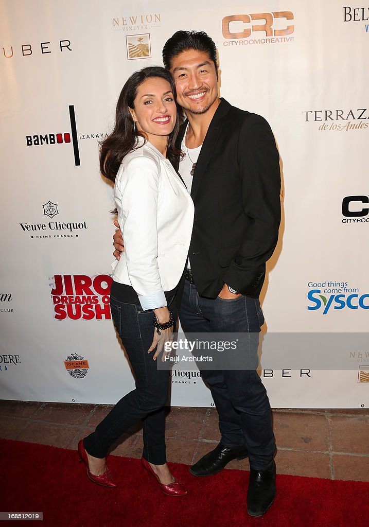 Actress Mirelly Taylor (L) and <a gi-track='captionPersonalityLinkClicked' href=/galleries/search?phrase=Brian+Tee&family=editorial&specificpeople=593958 ng-click='$event.stopPropagation()'>Brian Tee</a> (R) attend the grand opening of Bamboo Izakaya Restaurant at the Bamboo Izakaya Restaurant on May 9, 2013 in Santa Monica, California.