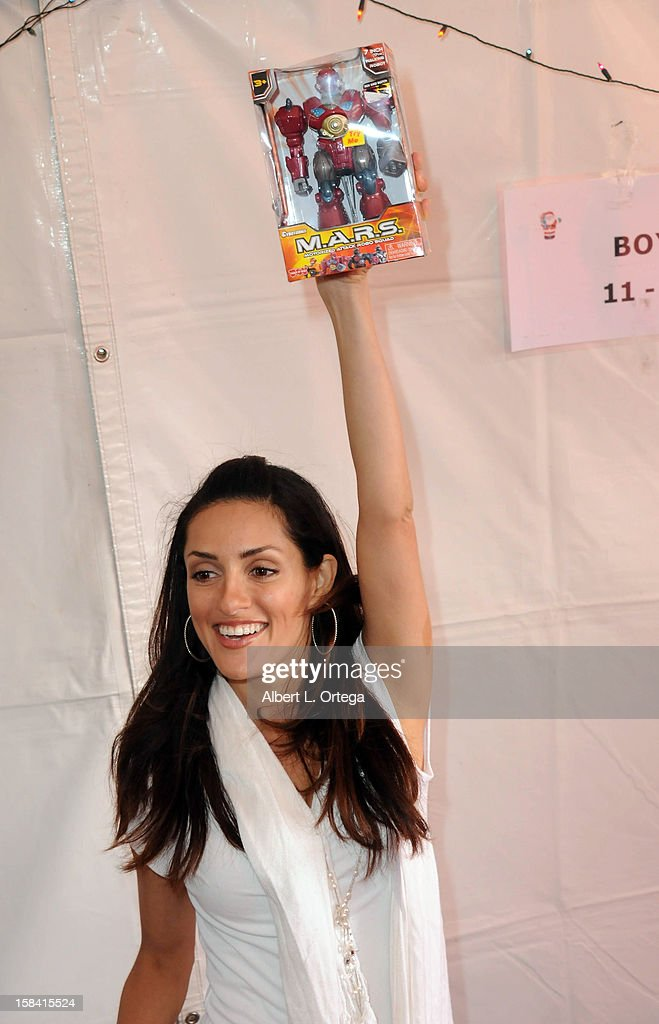 Actress Mirelly Taylor participates in The Heartfelt Foundation's 33rd Annual Christmas/Holiday Party For Children In Need held at The Santa Monica Pier on December 15, 2012 in Santa Monica, California.