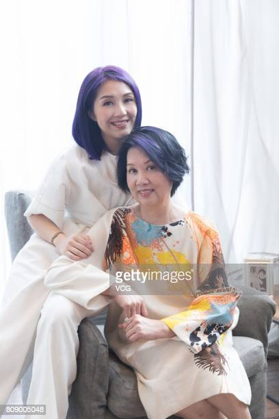 Actress Miriam Yeung poses during a commercial shoot for bank account product Citigold with her mother on July 4 2017 in Hong Kong China