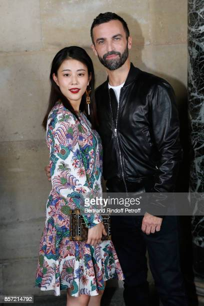 Actress Mitsuki Takahata ans stylist Nicolas Ghesquiere pose after the Louis Vuitton show as part of the Paris Fashion Week Womenswear Spring/Summer...