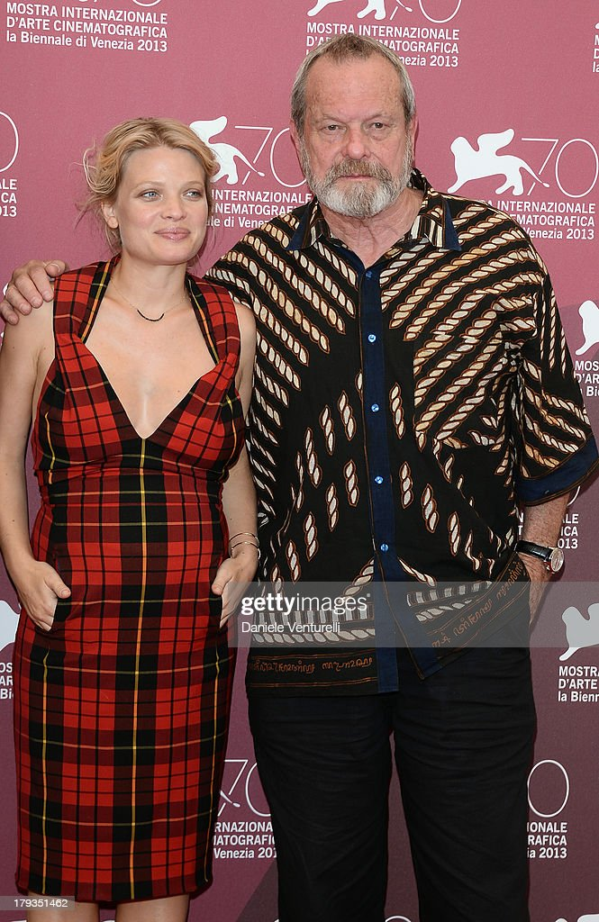 Actress Mélanie Thierry and Director <a gi-track='captionPersonalityLinkClicked' href=/galleries/search?phrase=Terry+Gilliam&family=editorial&specificpeople=221636 ng-click='$event.stopPropagation()'>Terry Gilliam</a> attend 'The Zero Theorem' Photocall during the 70th Venice International Film Festival at Palazzo del Casino on September 2, 2013 in Venice, Italy.