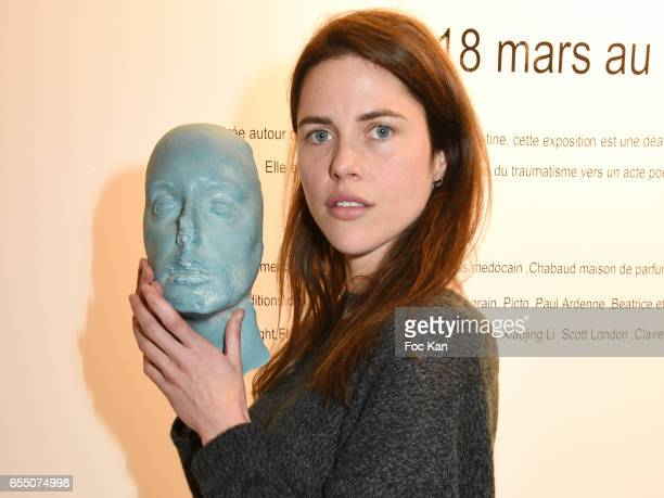 Actress /model Zoe Duchesne poses with Sarah Trouche's chocolate face sculpture during the 'Faccia A Faccia' Sarah Trouche performance exhibition at...