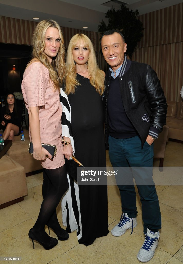 Actress Moilly Sims, Rachel Zoe and Elle Magazine Creative Director Joe Zee attend the relaunch of 'The Zoe Report' Hosted by FIJI Water at the Sunset Tower Hotel on November 20, 2013 in Los Angeles, California.