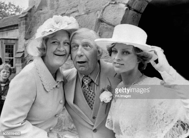 Actress Mollie Sugden from the BBC TV Comedy series 'Are You Being Served' poses with actor/comedian Arthur English and his bride 22 year old dance...