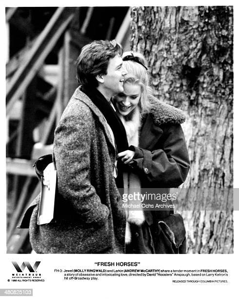 Actress Molly Ringwald and actor Andrew McCarthy in a scene from the movie ' Fresh Horses ' circa 1988