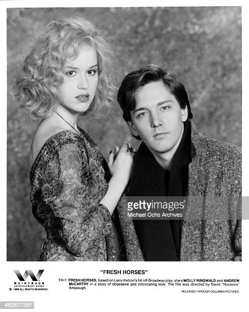 Actress Molly Ringwald and actor Andrew McCarthy pose for the movie ' Fresh Horses ' circa 1988