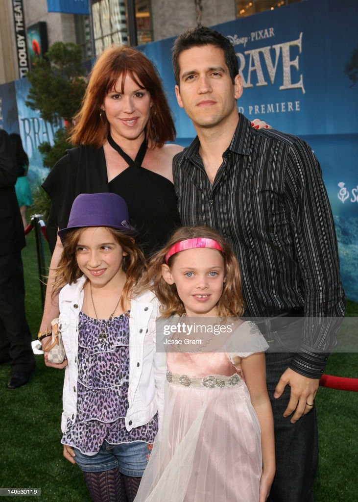 Actress <a gi-track='captionPersonalityLinkClicked' href=/galleries/search?phrase=Molly+Ringwald&family=editorial&specificpeople=206508 ng-click='$event.stopPropagation()'>Molly Ringwald</a> (L), Panio Gianopoulos (R) and guests arrive at Film Independent's 2012 Los Angeles Film Festival Premiere of Disney Pixar's 'Brave' at Dolby Theatre on June 18, 2012 in Hollywood, California.