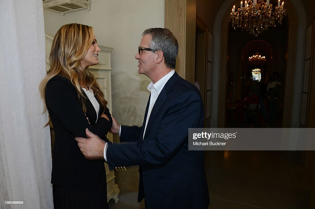 Actress <a gi-track='captionPersonalityLinkClicked' href=/galleries/search?phrase=Molly+Sims&family=editorial&specificpeople=202547 ng-click='$event.stopPropagation()'>Molly Sims</a> (L) and Carlos Alberini, CEO of Restoration Hardware, attend the Restoration Hardware Baby And Child Gallery Opening at Third Street Promenade on November 10, 2012 in Santa Monica, California.