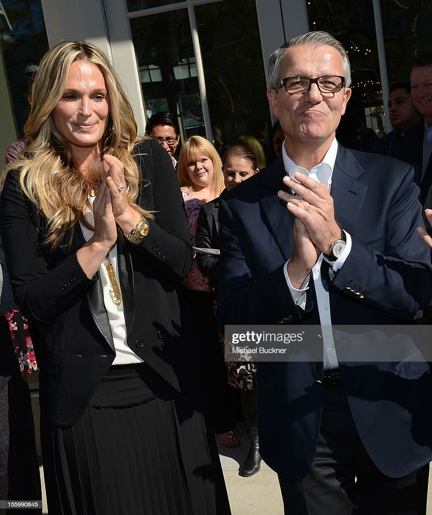 Actress Molly Sims (L) and Carlos Alberini, CEO Restoration Hardware, attend the Restoration Hardware Baby And Child Gallery Opening at Third Street Promenade on November 10, 2012 in Santa Monica, California.