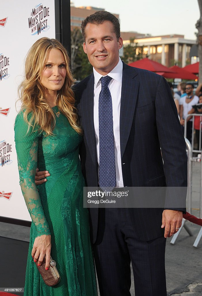 Actress Molly Sims and husband Scott Stuber arrive at the Los Angeles premiere of 'A Million Ways To Die In The West' at Regency Village Theatre on...