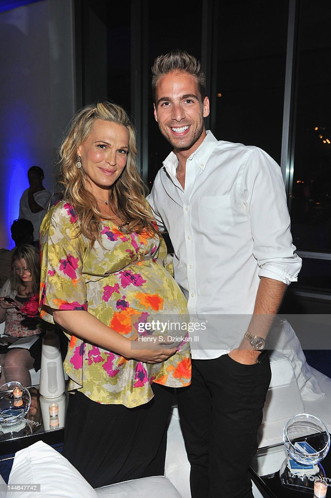 Actress <a gi-track='captionPersonalityLinkClicked' href=/galleries/search?phrase=Molly+Sims&family=editorial&specificpeople=202547 ng-click='$event.stopPropagation()'>Molly Sims</a> and Simon Huck attend Liz Lange for Target 10th Anniversary Party at The Glasshouses on May 16, 2012 in New York City.