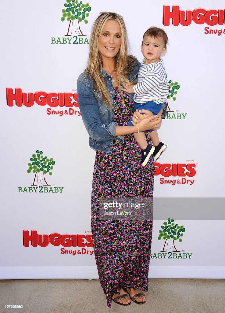Actress <a gi-track='captionPersonalityLinkClicked' href=/galleries/search?phrase=Molly+Sims&family=editorial&specificpeople=202547 ng-click='$event.stopPropagation()'>Molly Sims</a> and son Brooks Stuber attend the Baby2Baby Mother's Day garden party on April 27, 2013 in Los Angeles, California.