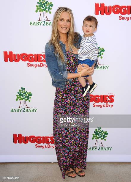 Actress Molly Sims and son Brooks Stuber attend the Baby2Baby Mother's Day garden party on April 27 2013 in Los Angeles California