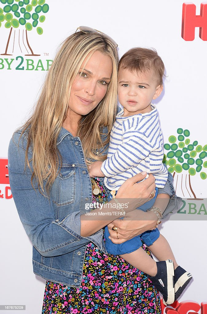 Actress <a gi-track='captionPersonalityLinkClicked' href=/galleries/search?phrase=Molly+Sims&family=editorial&specificpeople=202547 ng-click='$event.stopPropagation()'>Molly Sims</a> and son Brooks Stuber attends the Huggies Snug & Dry and Baby2Baby Mother's Day Garden Party held on April 27, 2013 in Los Angeles, California.