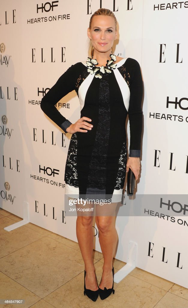 Actress <a gi-track='captionPersonalityLinkClicked' href=/galleries/search?phrase=Molly+Sims&family=editorial&specificpeople=202547 ng-click='$event.stopPropagation()'>Molly Sims</a> arrives at the ELLE Women In Television Celebration at Sunset Tower on January 22, 2014 in West Hollywood, California.