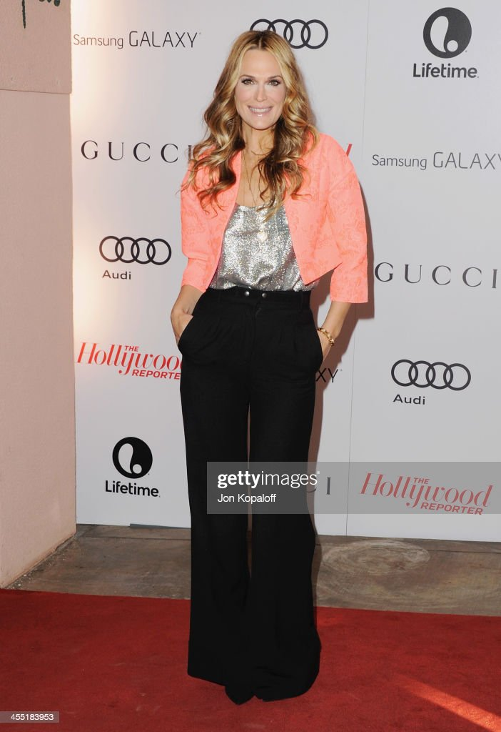 Actress <a gi-track='captionPersonalityLinkClicked' href=/galleries/search?phrase=Molly+Sims&family=editorial&specificpeople=202547 ng-click='$event.stopPropagation()'>Molly Sims</a> arrives at The Hollywood Reporter's 22nd Annual Women In Entertainment Breakfast 2013 at Beverly Hills Hotel on December 11, 2013 in Beverly Hills, California.