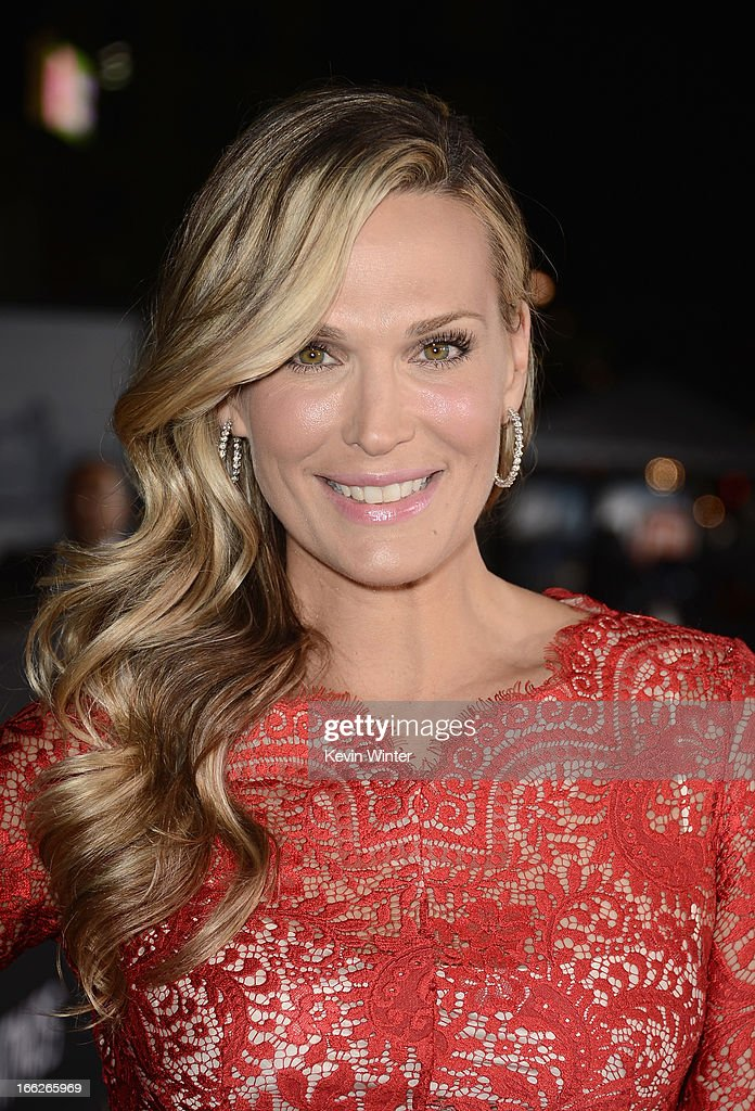 Actress Molly Sims arrives at the premiere of Universal Pictures' 'Oblivion' at Dolby Theatre on April 10, 2013 in Hollywood, California.