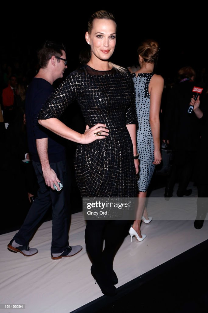 Actress Molly Sims attends the Carolina Herrera Fall 2013 fashion show during Mercedes-Benz Fashion Week at The Theatre at Lincoln Center on February 11, 2013 in New York City.