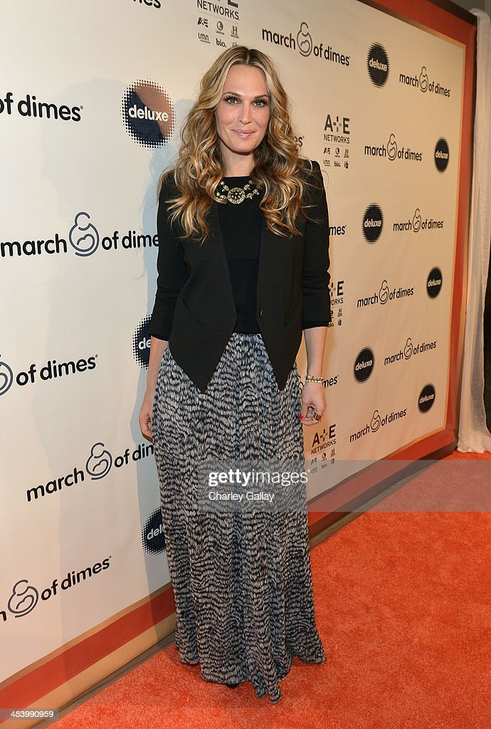 Actress <a gi-track='captionPersonalityLinkClicked' href=/galleries/search?phrase=Molly+Sims&family=editorial&specificpeople=202547 ng-click='$event.stopPropagation()'>Molly Sims</a> attends the March of Dimes Celebration of Babies Luncheon at Beverly Hills Hotel on December 6, 2013 in Beverly Hills, California.