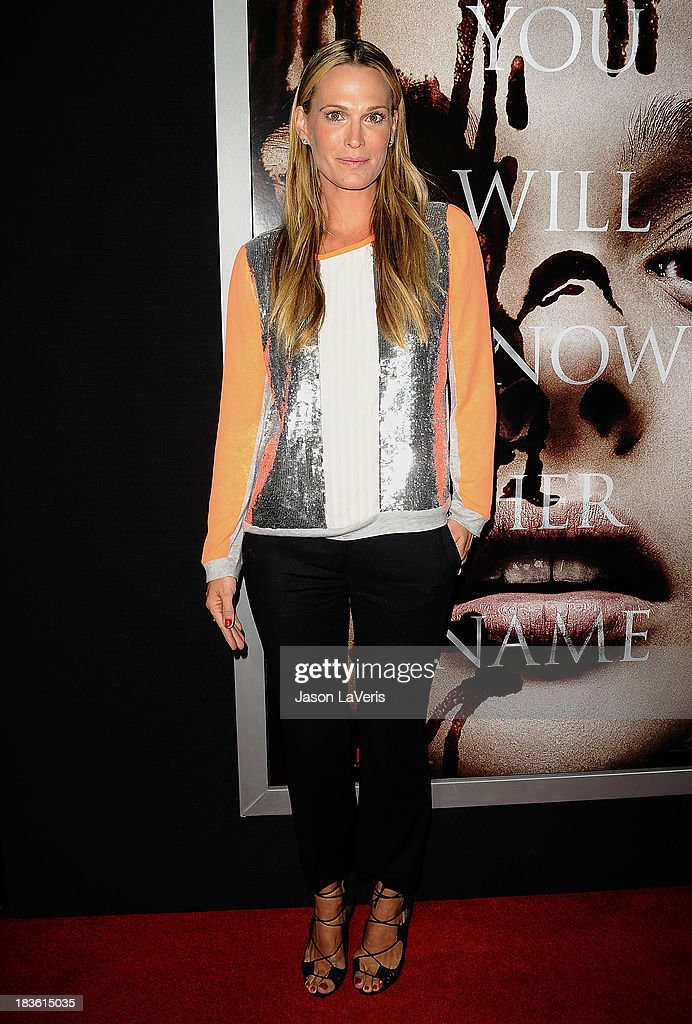 Actress <a gi-track='captionPersonalityLinkClicked' href=/galleries/search?phrase=Molly+Sims&family=editorial&specificpeople=202547 ng-click='$event.stopPropagation()'>Molly Sims</a> attends the premiere of 'Carrie' at ArcLight Hollywood on October 7, 2013 in Hollywood, California.