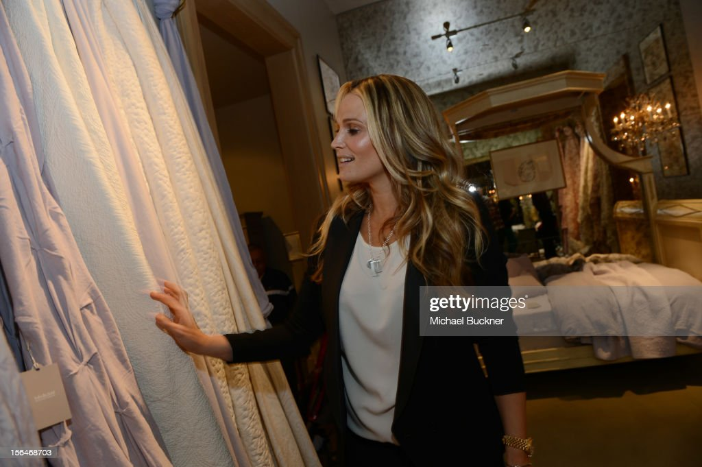 Actress <a gi-track='captionPersonalityLinkClicked' href=/galleries/search?phrase=Molly+Sims&family=editorial&specificpeople=202547 ng-click='$event.stopPropagation()'>Molly Sims</a> attends the Restoration Hardware Baby And Child Gallery Opening at Third Street Promenade on November 10, 2012 in Santa Monica, California.
