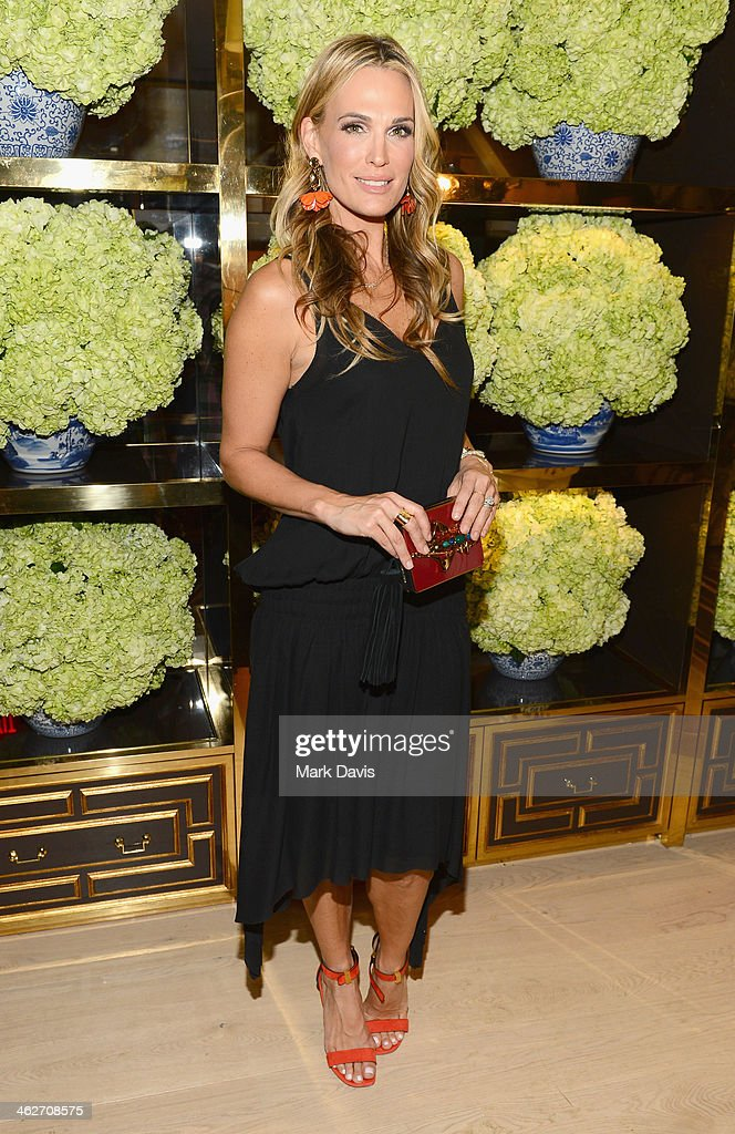 Actress <a gi-track='captionPersonalityLinkClicked' href=/galleries/search?phrase=Molly+Sims&family=editorial&specificpeople=202547 ng-click='$event.stopPropagation()'>Molly Sims</a> attends the Tory Burch Rodeo Drive Flagship Opening at Tory Burch on January 14, 2014 in Beverly Hills, California.