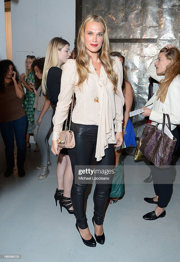 Actress <a gi-track='captionPersonalityLinkClicked' href=/galleries/search?phrase=Molly+Sims&family=editorial&specificpeople=202547 ng-click='$event.stopPropagation()'>Molly Sims</a> attends the Zac Posen fashion show during Mercedes-Benz Fashion Week Spring 2014 at Center 548 on September 8, 2013 in New York City.