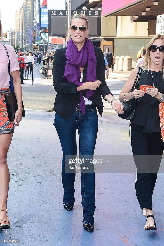 Actress Molly Sims walks in Times Square on August 21, 2013 in New York City.