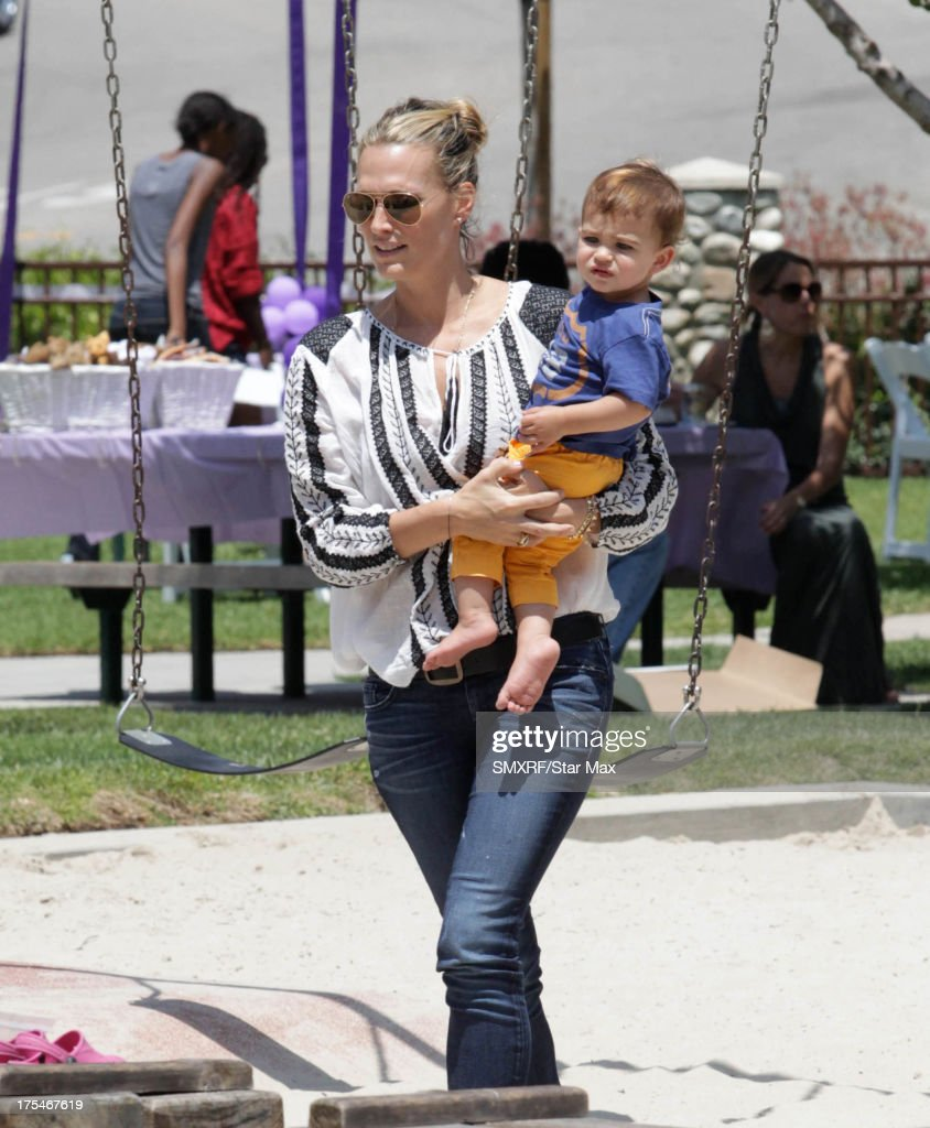 Actress <a gi-track='captionPersonalityLinkClicked' href=/galleries/search?phrase=Molly+Sims&family=editorial&specificpeople=202547 ng-click='$event.stopPropagation()'>Molly Sims</a> with her son, Brooks Alan Stuber, as seen on August 3, 2013 in Los Angeles, California.
