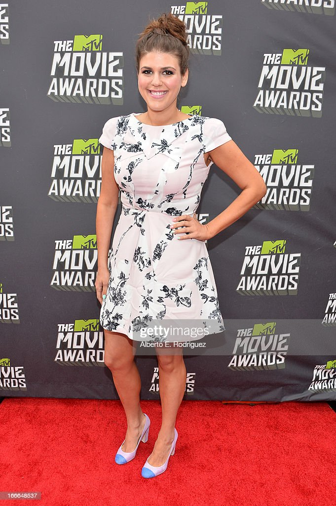 Actress Molly Tarlov arrives at the 2013 MTV Movie Awards at Sony Pictures Studios on April 14, 2013 in Culver City, California.