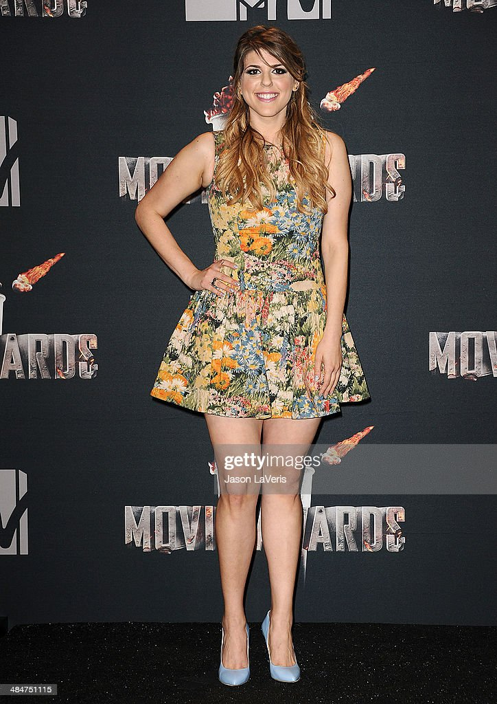 Actress <a gi-track='captionPersonalityLinkClicked' href=/galleries/search?phrase=Molly+Tarlov&family=editorial&specificpeople=7810085 ng-click='$event.stopPropagation()'>Molly Tarlov</a> poses in the press room at the 2014 MTV Movie Awards at Nokia Theatre L.A. Live on April 13, 2014 in Los Angeles, California.