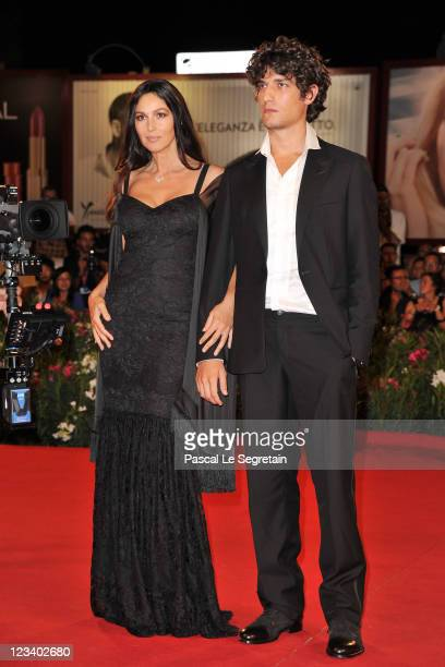 Actress Monica Bellucci and actor Louis Garrel attend the 'Un Ete Brulant' premiere during the 68th Venice Film Festival at Palazzo del Cinema on...