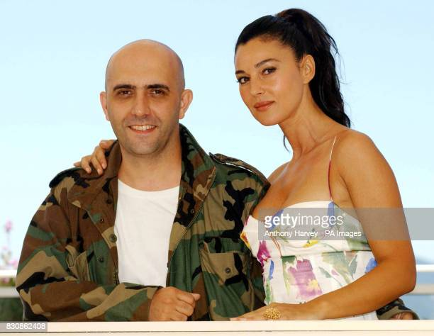 Actress Monica Bellucci and Director Gaspar Noe during a photocall for their new film 'Irreversible' at the Palais des Festival during the 55th...