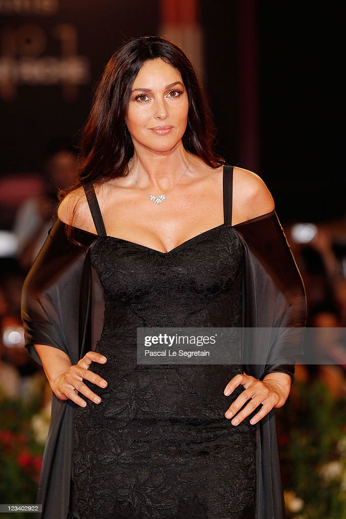 Actress <a gi-track='captionPersonalityLinkClicked' href=/galleries/search?phrase=Monica+Bellucci&family=editorial&specificpeople=204777 ng-click='$event.stopPropagation()'>Monica Bellucci</a> attends the 'Un Ete Brulant' premiere during the 68th Venice Film Festival at Palazzo del Cinema on September 2, 2011 in Venice, Italy.