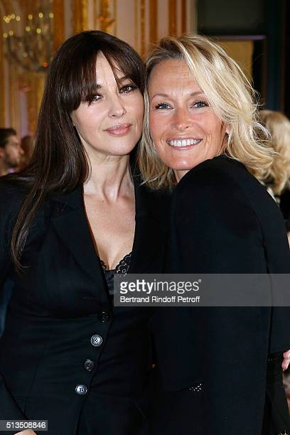 Actress Monica Bellucci dressed in Dior with Bag Louis Vuitton and Model Estelle Lefebure attend the 'International Women's Day Luncheon in Support...