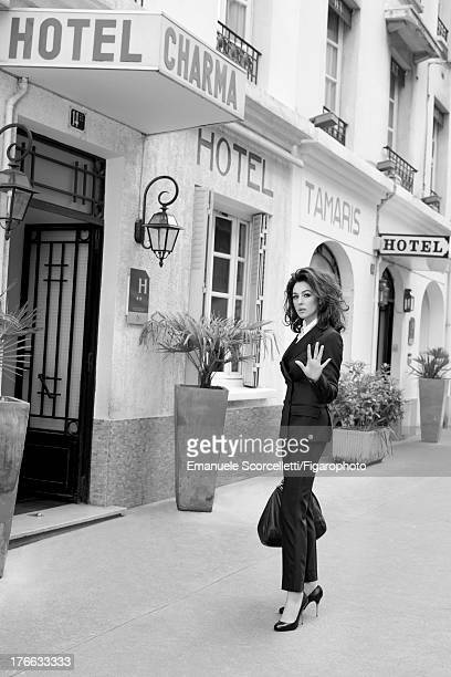 107162003 Actress Monica Bellucci is photographed for Madame Figaro on June 19 2013 in Paris France Suit shirt and bag necklace and watch shoes...