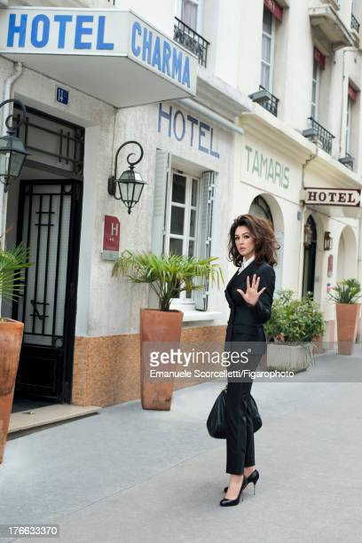 107162012 Actress Monica Bellucci is photographed for Madame Figaro on June 19 2013 in Paris France Suit shirt and bag necklace and watch shoes...