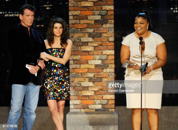 Actress Mo'Nique accepts Best Supporting Female award for 'Precious' with presenters Pierce Brosnan and Marisa Tomei onstage during the 25th Film...