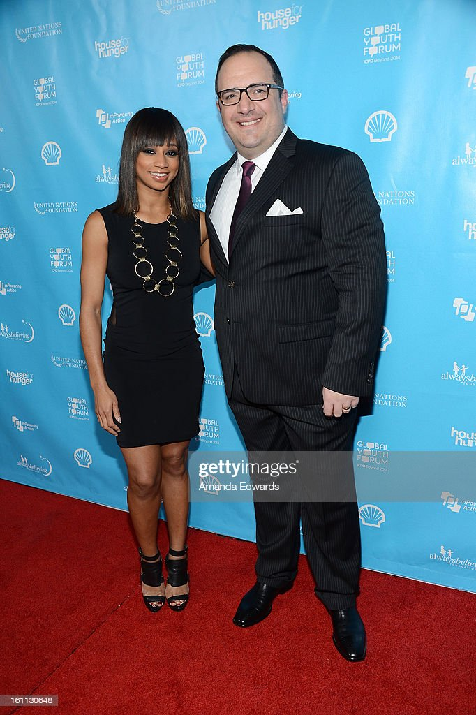 Actress <a gi-track='captionPersonalityLinkClicked' href=/galleries/search?phrase=Monique+Coleman&family=editorial&specificpeople=614618 ng-click='$event.stopPropagation()'>Monique Coleman</a> (L) and Aaron Shernian arrive at the United Nations Foundation's 'mPowering Action' Innovative Mobile Platform launch party at The Conga Room at L.A. Live on February 8, 2013 in Los Angeles, California.