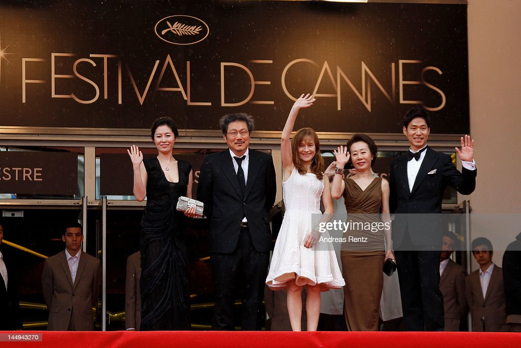 Actress Moon So-ri,director Sang-soo Hong, <a gi-track='captionPersonalityLinkClicked' href=/galleries/search?phrase=Isabelle+Huppert&family=editorial&specificpeople=662796 ng-click='$event.stopPropagation()'>Isabelle Huppert</a>, actor Yu Jun-Sang and actress Youn Yuh-jung attend the 'Da-reun Na-ra-e-suh' Premiere during the 65th Annual Cannes Film Festival at Palais des Festivals on May 21, 2012 in Cannes, France.